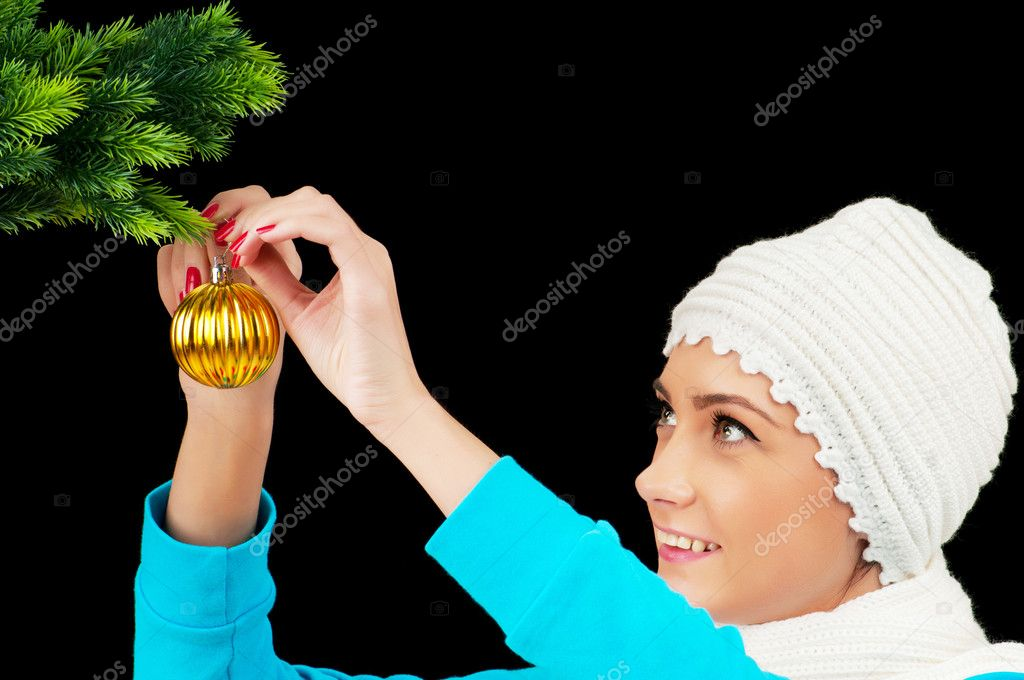 Young girl decorating christmas tree isolated on black — Stock Photo #5135227