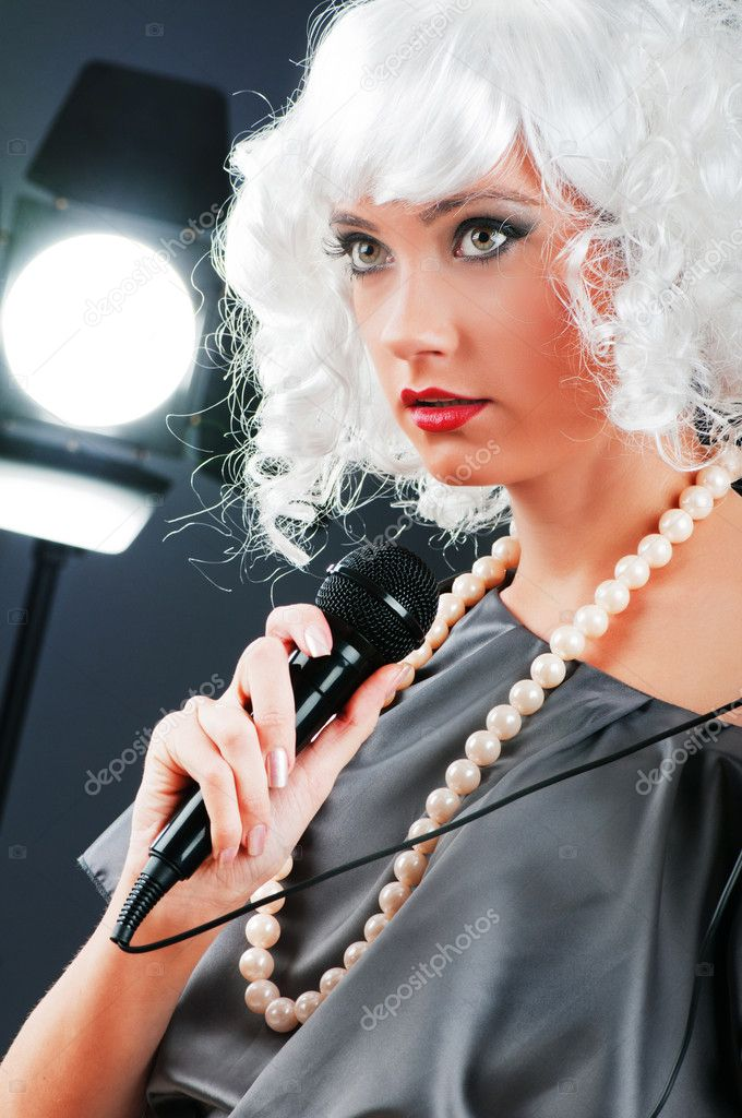Pop star singing the song at concert — Stock Photo #5135501