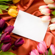Envelope and flowers on the satin background — Stock Photo #5145196