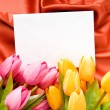 Envelope and flowers on satin background — Stock Photo #5145202