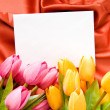 Envelope and flowers on the satin background - ストック写真