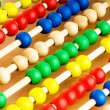 Education concept - Abacus with many colorful beads — Stock Photo #5146391