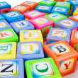 Learning and education concept - pile of alphabet blocks — ストック写真