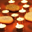Burning candles and pebbles for aromatherapy session — Stockfoto