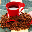 Stock Photo: Cup of coffee with many beans around