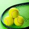 Tennis concept with balls and racket — Stock Photo #5149791