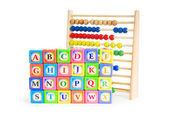 Alphabet blocks and abacus isolated on white — Stock Photo