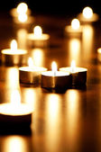 Many burning candles with shallow depth of field — Stock Photo
