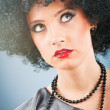 Young attractive girl with afro curly haircut — Stock Photo #5162364