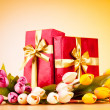 Celebration concept - gift box and tulip flowers — Stock Photo #5167710