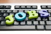 Employment concept with words on keyboard — Stock Photo