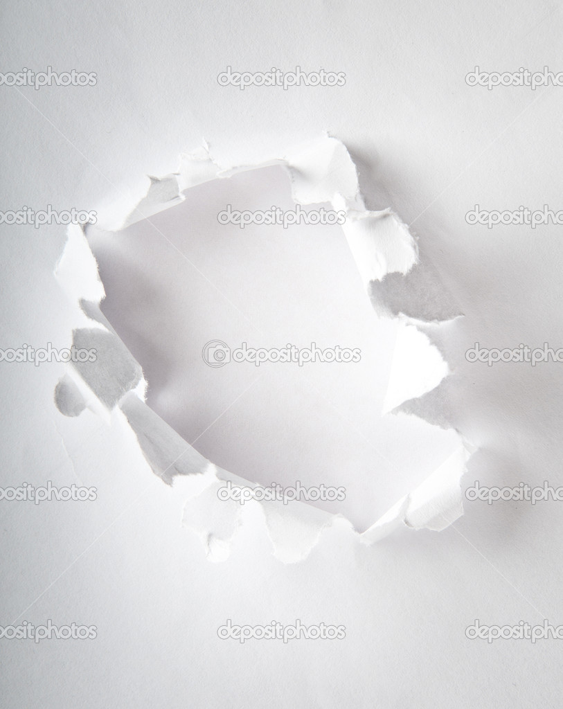 Hole in the paper with torn sides — Stock Photo #5163489