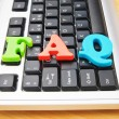 FAQ concept with letters on keyboard — Stock Photo #5185788