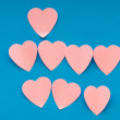 Heart shaped sticky notes on the background — Stock Photo #5186965
