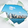New York city through hole in paper — Stock Photo