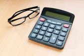 Business concept with accounting calculator — Stock Photo