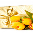 Celebration concept - gift box and tulip flowers — Stock Photo #5191998