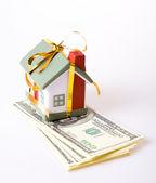 Miniature house over money — Stock Photo