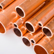 Copper pipes of different diameter — Stock Photo #5259253