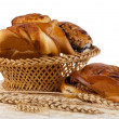 Stock Photo: Buns with cinnamon and wheat ears.
