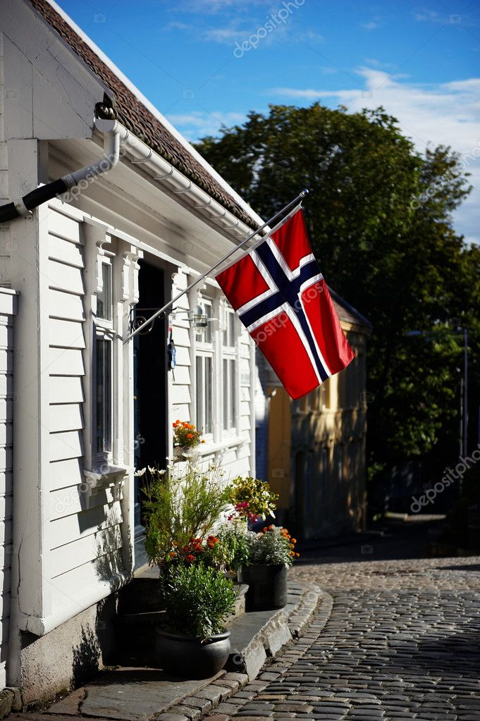 White house with flag in old part of Stavanger, Norway  Stock Photo #3966240