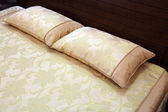 Pillow on a bed — Stockfoto