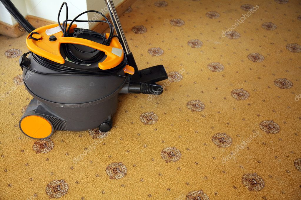 Vacuum cleaner on a carpet covering in hotel  Stock Photo #4629158