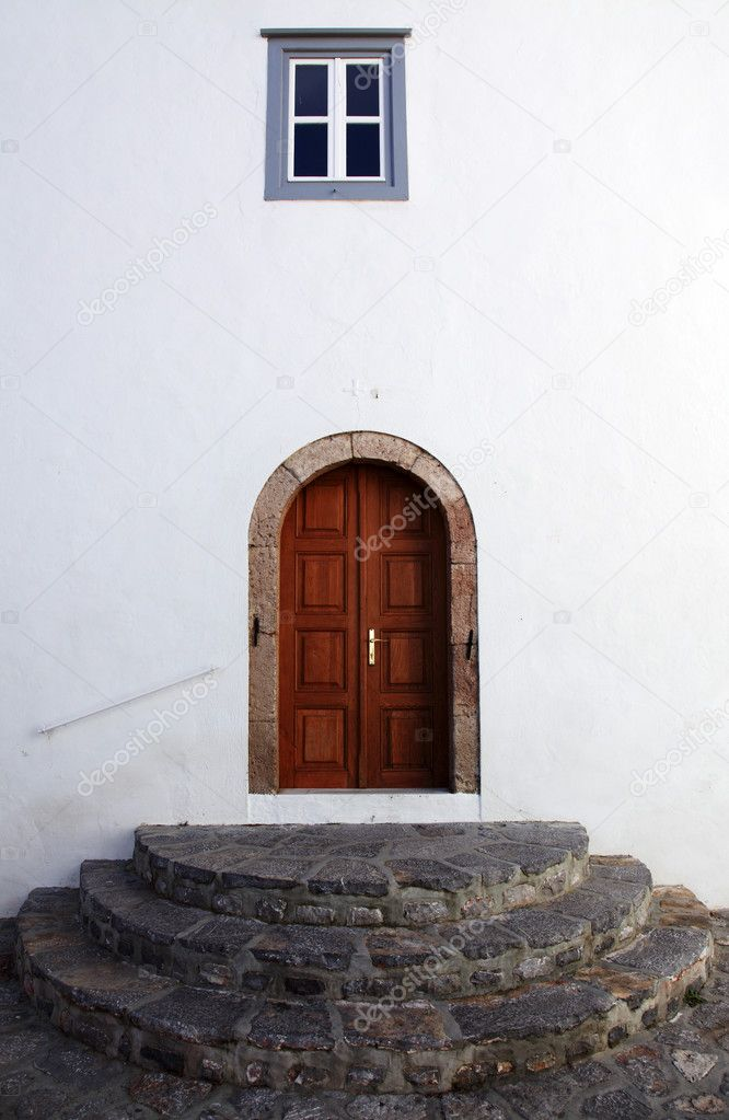 Entrance in church, a door against a white wall — Stock Photo #4631094