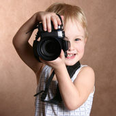 Child with camera — Stock Photo