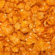 Background of goldish corn flakes — Stock Photo #4300415