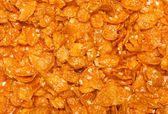 Background of goldish corn flakes — Stock Photo