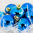 Christmas ball in tinsel — Stock Photo