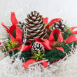 Christmas tree with a pinecone in tinsel — Stock Photo