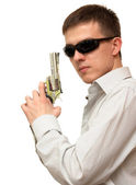A guy with a gun in his hand wearing sunglasses on a white backg — Stock Photo