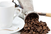 Coffee grains in a white cup and disseminated about a coffee pot — Stock Photo