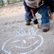 Draw with chalk on the pavement - Stock Photo