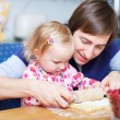 Father and daughter baking together — Stock Photo #3941174
