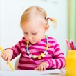 Toddler girl coloring with pencils — Stock Photo