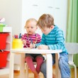 Two kids drawing together — Stock Photo