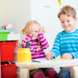 Kids sitting together at table drawing — Stock Photo #3941395