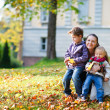 Mother and kids at autumn park — Stock Photo #3943826