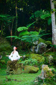 Woman meditating outdoors — Stock Photo