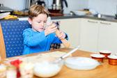 Boy helping at kitchen — Stock Photo