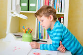 School boy doing homework at home — Stock Photo
