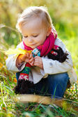Toddler girl in autumn park — Stock Photo