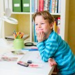 Cute little boy studying - Stock Photo