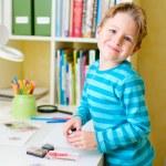 Cute little boy studying — Stock Photo #3994795