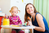 Mother and daughter playing together — Stock Photo
