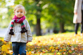 Toddler girl in autumn park — Stock Photo