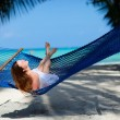 Woman relaxing in hammock — Stock Photo #4045643